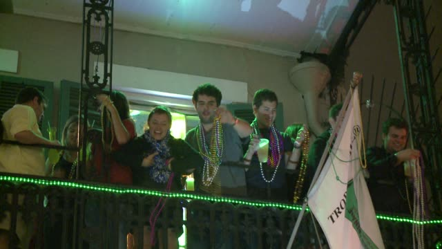 mardi gras on bourbon street revelers plead for beads during mardi gras on march 08 2011 in new orleans louisiana - bead stock videos & royalty-free footage