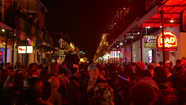 Mardi Gras revelers pack Bourbon Street during Mardi Gras celebrations in New Orleans