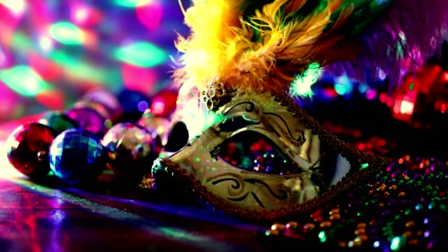 mardi gras, rio carnival mask and colorful beads and feather decorations. - new orleans mardi gras stock videos and b-roll footage