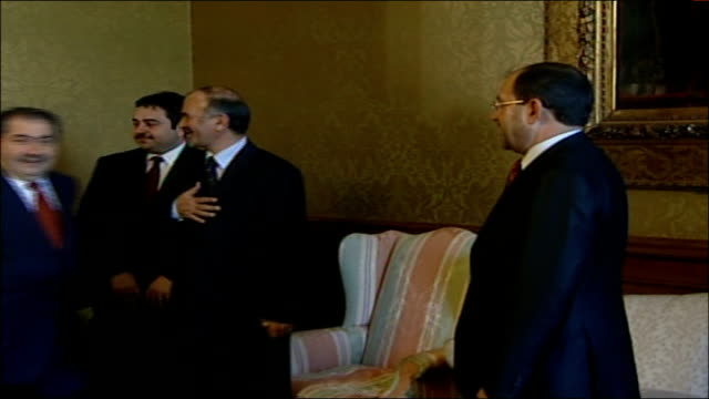 margaret beckett meets iraqi prime minister nouri almaliki england london downing street int nouri almaliki along into room with other officials /... - iraqi prime minister stock videos & royalty-free footage
