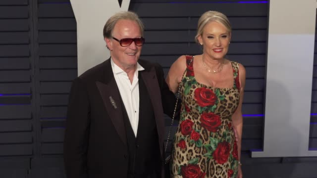 margaret devogelaere and peter fonda at 2019 vanity fair oscar party hosted by radhika jones at wallis annenberg center for the performing arts on... - vanity fair oscar party stock videos & royalty-free footage