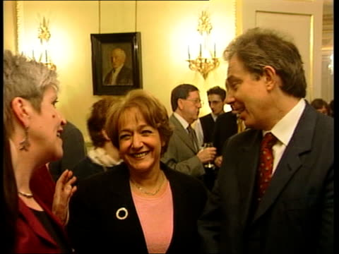 margaret hodge criticised over handling of abuse allegations itn margaret hodge standing beside tony blair mp at reception - マーガレット・ホッジ点の映像素材/bロール