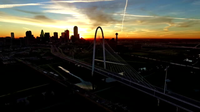 Margaret Hunt Hill Bridge during Epic Dramatic Sunrise Dallas Texas downtown skyline aerial cityscape
