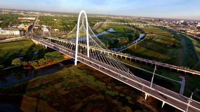 margaret hunt hill bridge spanning across the trinity river in dallas texas during sunirse - dallas stock videos & royalty-free footage