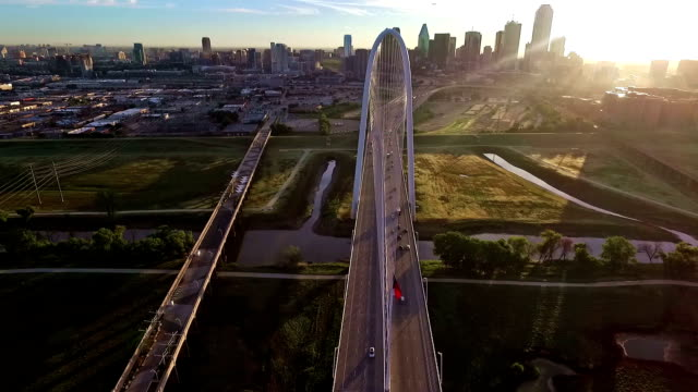 margaret hunt hill bridge spanning across the trinity river in dallas texas during sunirse sun burst morning - dallas stock videos & royalty-free footage