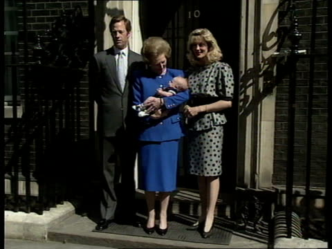 PM Margaret Thatcher and Grandson **** FOR ENGLAND London Downing Street No 10 Ext PM Margaret Thatcher in dark blue suit poses with grandson Michael...