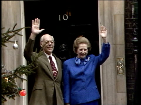 Margaret Thatcher becomes longest serving PM this century ITN London 10 Downing St Thatchers standing waving next Xmas tree and turn to BV into No 10