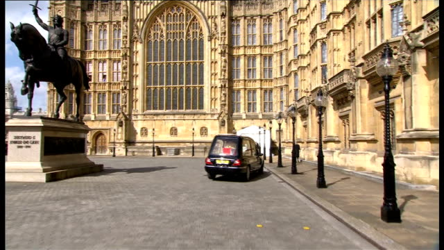 body moved to crypt chapel of st mary undercroft in westminster england london houses of parliament ext hearse arriving with police escort flagdraped... - crypt stock videos and b-roll footage