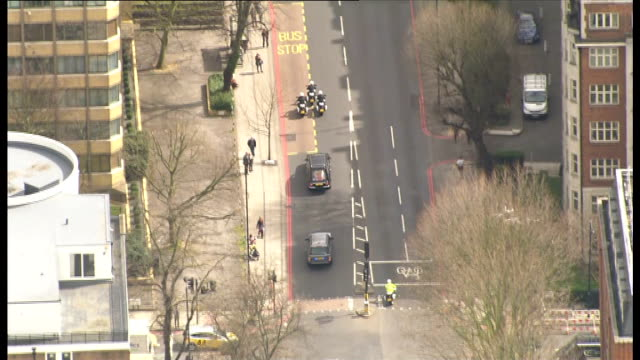 margaret thatcher death: body moved to crypt chapel of st mary undercroft in westminster: aerials hearse; air views hearse with police escort along... - crypt stock videos & royalty-free footage