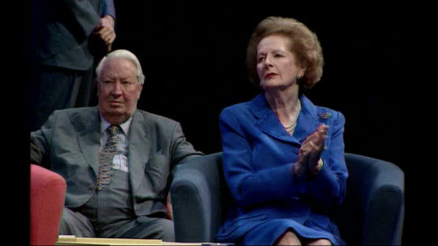 margaret thatcher death: obituary; t07109804 bsp071098013 / dorset: bournemouth: thatcher clapping as sitting next to edward heath - edward heath stock-videos und b-roll-filmmaterial