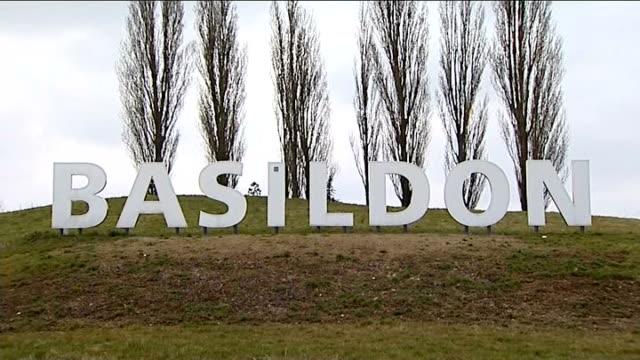 margaret thatcher death: reaction; england: essex: basildon: ext 'basildon' sign on grass as van passes in f/g traffic along road beside sign - basildon stock videos & royalty-free footage