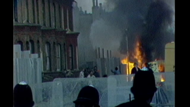 vídeos de stock, filmes e b-roll de report from brixton s29031001 april 1981 england london brixton ext various shots police officers holding riot shields as petrol bombs bricks and... - brixton