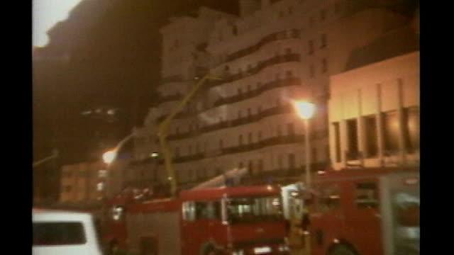 margaret thatcher dies aged 87; england: sussex: brighton: ext / night bomb-damaged front of grand hotel night ends - 英国 ブライトン点の映像素材/bロール