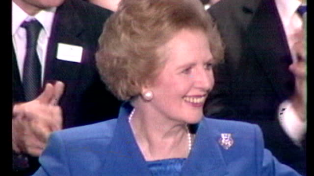 1980's int margaret thatcher mp waving from stage at conservative party conference as applauded by cabinet members and audience freeze 1980's ends... - retail occupation stock videos and b-roll footage