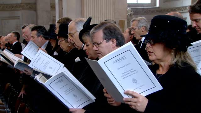 1100 1200 choir and congregation sing hymn love divine all loves excelling sot cutaways including choir/ wide shots of cathedral interiors/ lech... - sir menzies campbell bildbanksvideor och videomaterial från bakom kulisserna