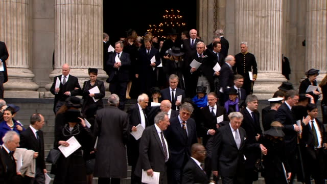 margaret thatcher funeral: funeral service; int candles being snuffed out/ high angle shot of congregation leaving/ ext katherine jenkins departure/... - andrew neil stock videos & royalty-free footage