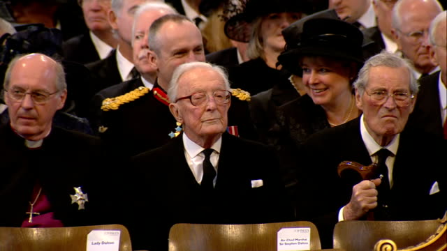margaret thatcher funeral: funeral service; steps of the cathedral lined with soldiers and chelsea pensioners / richard chartres and other clergy /... - michael crawford点の映像素材/bロール