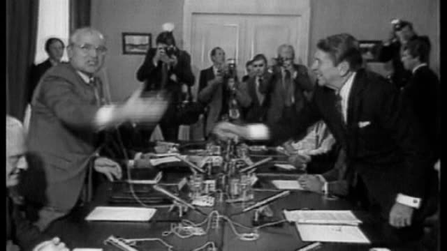 historical legacy SWITZERLAND Geneva President Ronald Reagan handshake across table with Mikhail Gorbachev during nuclear disarmament talks