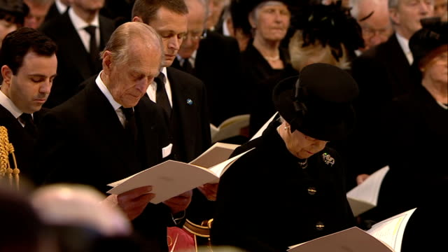 margaret thatcher funeral: st paul's cathedral arrivals and start of service; reverend david ison addresses congregation sot cutaways wide shots of... - religious service stock videos & royalty-free footage