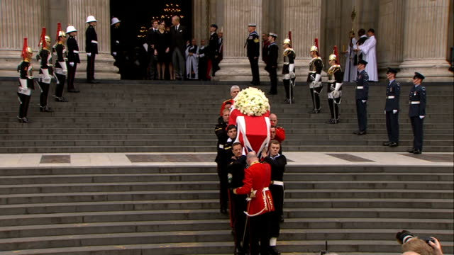 st paul's cathedral funeral service ext various of coffin as carried from cathedral and down steps as cathedral bells heard tolling sot/ mark... - hearse stock videos & royalty-free footage