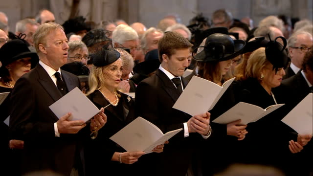 st paul's cathedral funeral service **music heard over following** various of congregation singing hymn to be a pilgrim including close shots of sir... - tim rice stock videos and b-roll footage