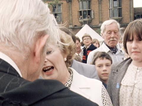 margaret thatcher greets former prime minister harold macmillan at a centenary garden party for somerville college - centesimo anniversario video stock e b–roll