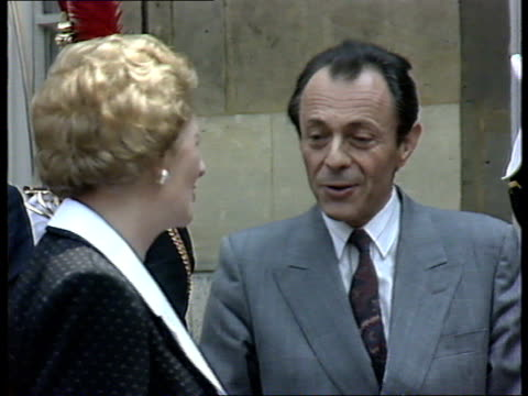 Margaret Thatcher in Paris Elysee Palace Arrival into courtyard Mrs Thatcher in Rolls greetedby French Prime Minister Michel Rocard/ Rocard and...