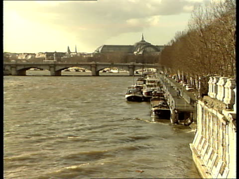 margaret thatcher in paris ext louvre from river barges moored along edge of seine/ bridge across river notre dame in b/g/ gvs musee d'orsay/ gvs... - eiffel tower stock videos & royalty-free footage