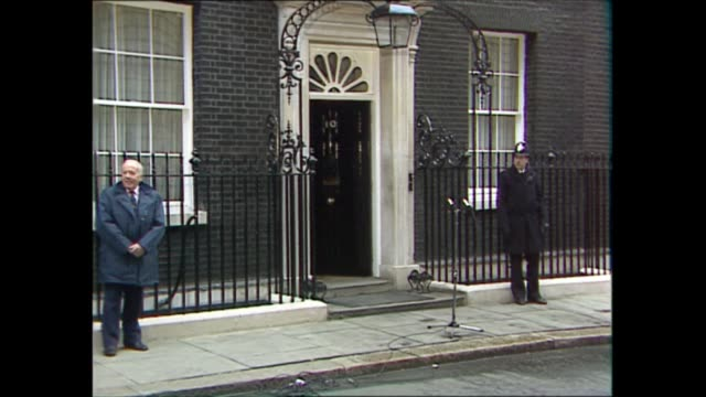 margaret thatcher leaves downing street / john major moves in:; england: london: westminster: downing street: ext staff carry suitcases out along... - carrying stock videos & royalty-free footage