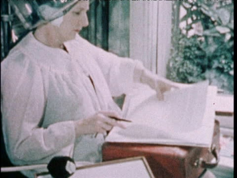 margaret thatcher minister for education doing paperwork whilst having hair set in salon london; 11 feb 72 - multitasking stock videos & royalty-free footage