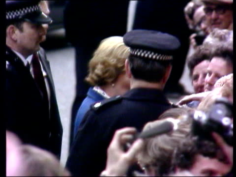 margaret thatcher mp arrives to take office / thatcher greets members of the crowd in downing street / margaret thatcher waves to crowd from steps of... - elezioni generali video stock e b–roll