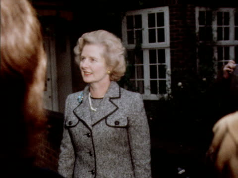 margaret thatcher poses for photographs outside her house after winning the tory leadership election 1975 - 1975 stock videos & royalty-free footage
