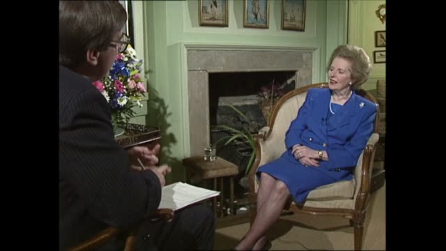 margaret thatcher to step down as interview: part three; clip 4 of 4 england: london: int michael brunson question sot - asks about the collapse of... - {{relatedsearchurl(carousel.phrase)}} video stock e b–roll