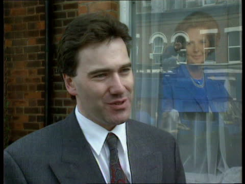 finchley reactions itn ext ms poster of margaret thatcher in tory offices window pull out pm poster of john major in adjoining window pull out tory... - finchley stock videos and b-roll footage