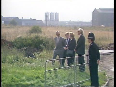day 1 d england teeside margaret thatcher changing shoes tilt down zoom in lms track back thatcher with man and entourage walk towards across... - b rolle stock-videos und b-roll-filmmaterial