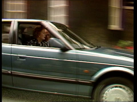 stockvideo's en b-roll-footage met margaret thatcher tries out rover 800 england london outside no 10 thatcher and denis looking at engine of their new 'blue'rover 800 thatcher drives... - neil kinnock