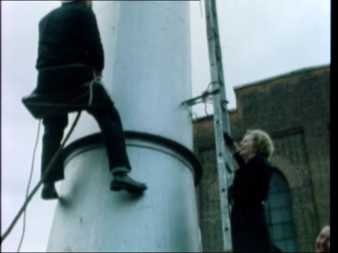 margaret thatcher walkabout in south london a nat story england south london ms margaret thatcher climbs up ladder on very high storage tank tilt up... - leiter stock-videos und b-roll-filmmaterial