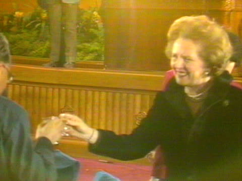 margaret thatcher walks around a table at a banquet in beijing and clinks glasses with various dignitaries following the signing of the sinobritish... - variation stock videos & royalty-free footage
