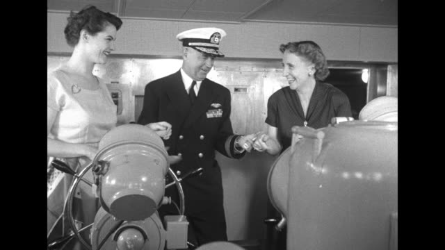 stockvideo's en b-roll-footage met margaret truman daughter of us pres harry truman plays shuffleboard with her friend drucie snyder aboard the liner ss united states / she visits... - margaret truman