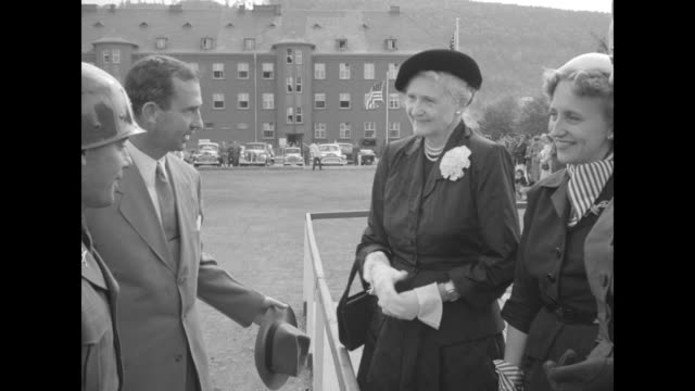 margaret truman is introduced by us secretary of army frank pace to us officers, margaret's friend drucie snyder horton, daughter of us secretary of... - 西ドイツ点の映像素材/bロール