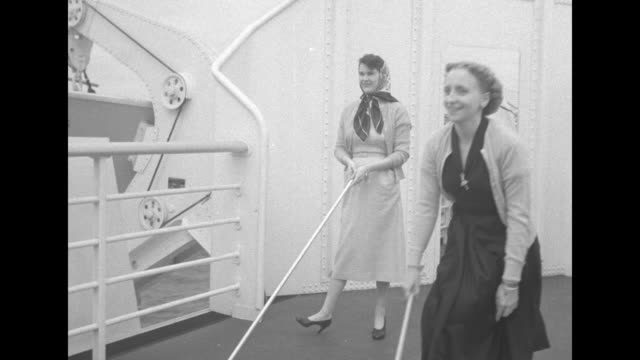 stockvideo's en b-roll-footage met vs margaret truman plays shuffleboard with friend drucie snyder / a whiteuniformed nurse attends to children in the ship's nursery and holds a tray... - margaret truman