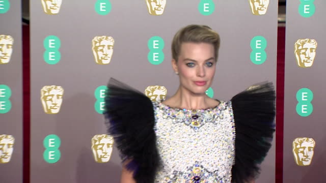 stockvideo's en b-roll-footage met margot robbie poses for photos on red carpet at bafta film awards at royal albert hall - 2019