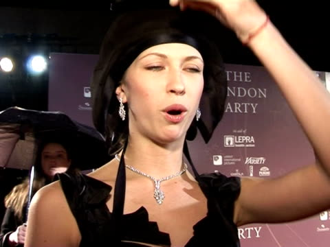 margot stilley talks about dita von teese's cabaret performance at the harper's bazaar party at the prebafta awards party the london party on... - dita von teese stock videos & royalty-free footage