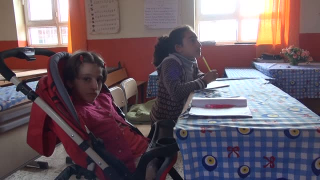 maria altay who is armless and legless goes to school and writes with her mouth and uses computer with her chin in east anatolian city mardin of... - chin stock videos and b-roll footage