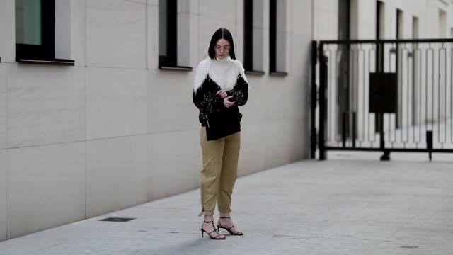 maria barteczko wearing black and white two tone turtleneck wool sweater from givenchy beige cargo pants from chloe leather strap sandals from zara... - chloe designer label stock videos and b-roll footage