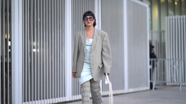 maria bernad wears sunglasses an oversized blazer jacket a pale blue dress a striped skirt brown leather shoes outside jacquemus during paris fashion... - sunglasses stock videos & royalty-free footage