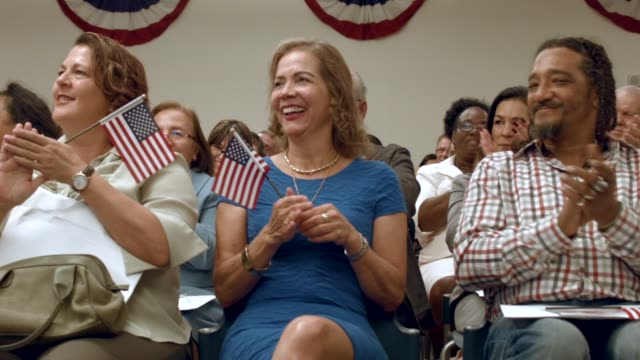 maria elena and others become american citizens during a us citizenship immigration services naturalization ceremony at the hialeah field office on... - 市民点の映像素材/bロール