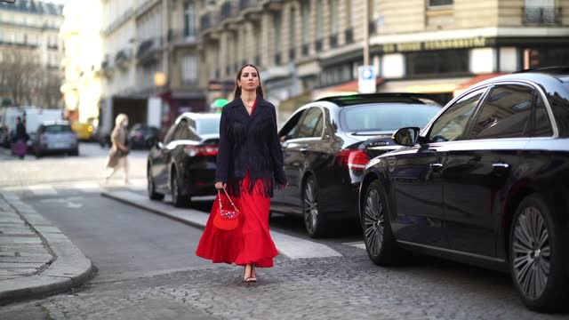 "maria rosaria rizzo aka ""la coquette italienne"" wears a red dress from parosh, a dark navy blue jacket with long fringes and pockets from parosh, a... - long hair stock videos & royalty-free footage"