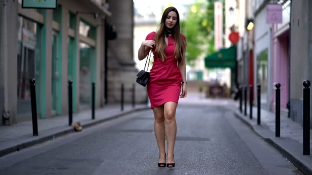 Maria Rosaria Rizzo fashion blogger La Coquette Italienne wears a Meriella Rosati pink dress Sergio Rossi heels shoes a Chanel bag a John Galliano...
