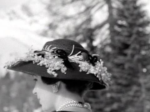 maria scarafia models a black hat decorated with lilly of the valley during an open air fashion show in st moritz - lebewesen stock-videos und b-roll-filmmaterial